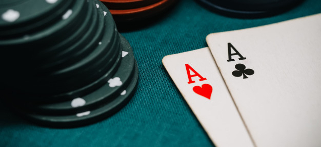one-pair-aces-playing-chips-game-poker_118086-1976